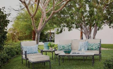 White cushions on metal outdoor furniture frames