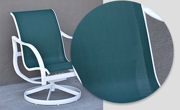 white swivel outdoor chair with a dark green sling and a section zoomed in to a portion of the chair