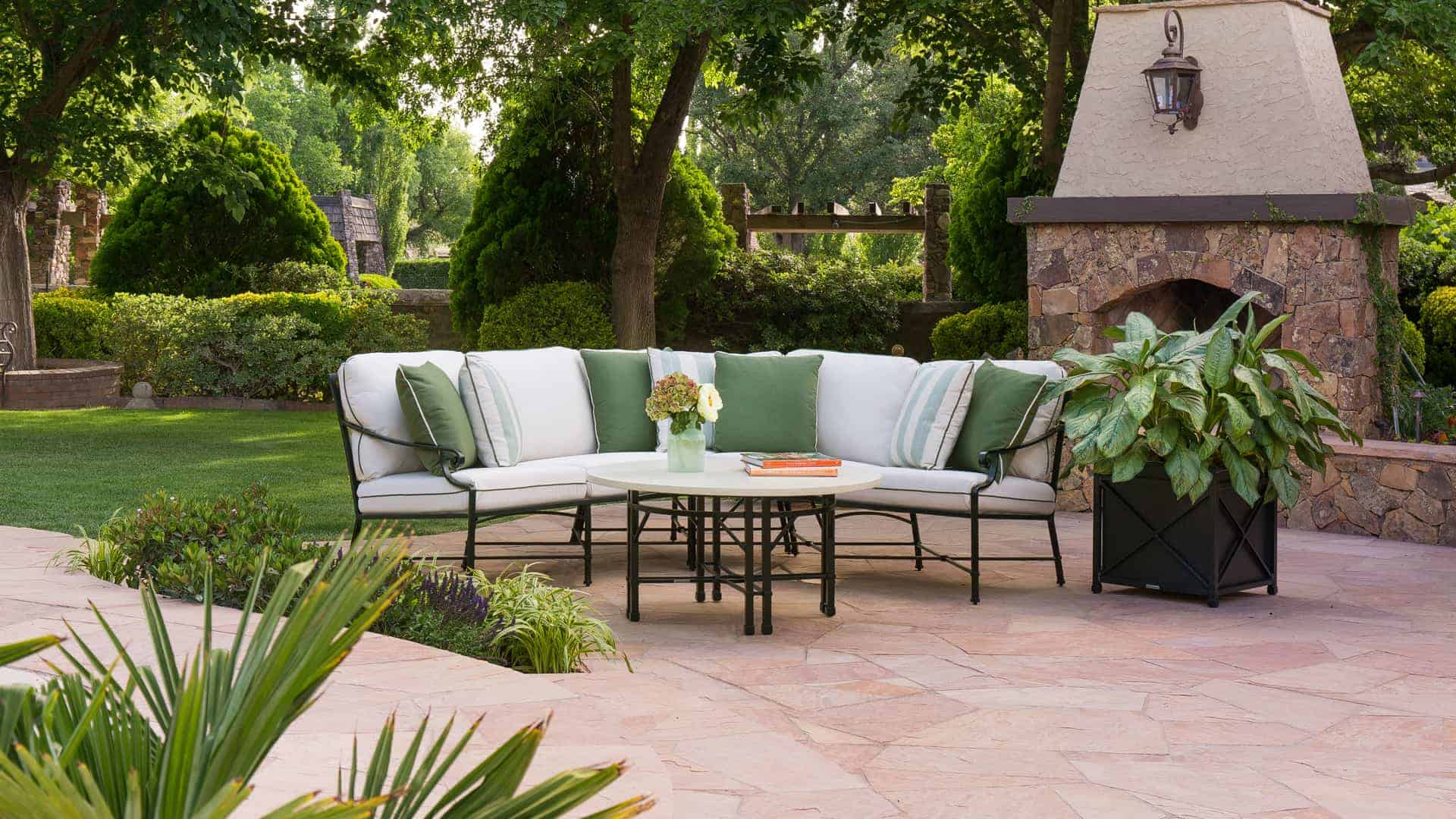 White outdoor couch with green cushions