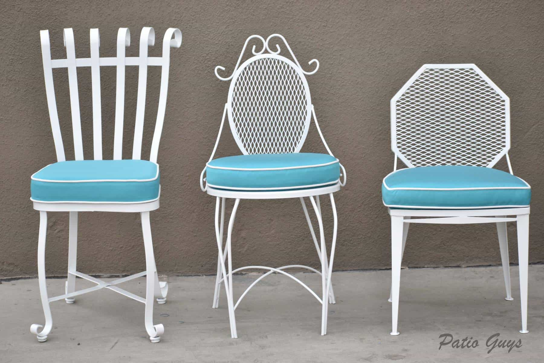 light blue cushions on white wrought iron garden chair