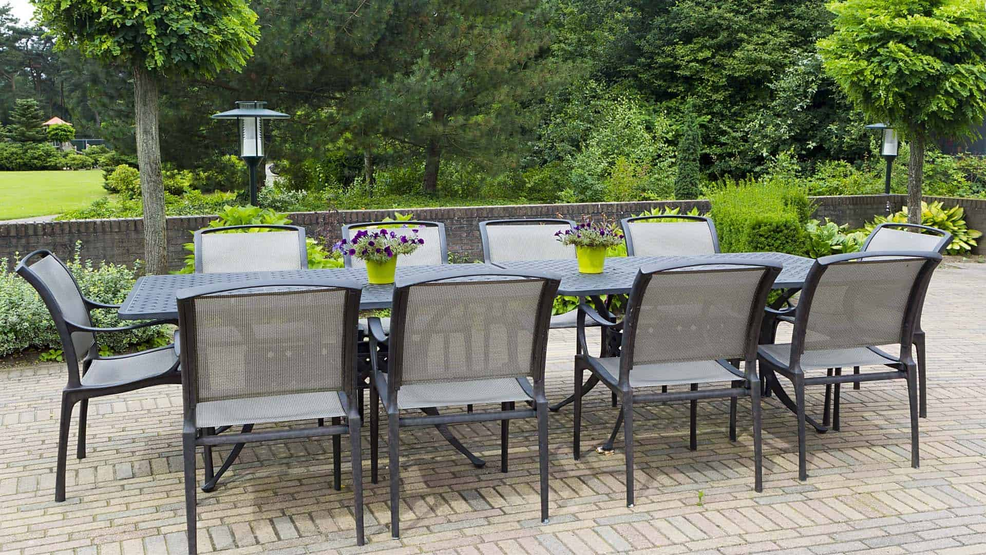 Sling chairs and metal table overlooking garden