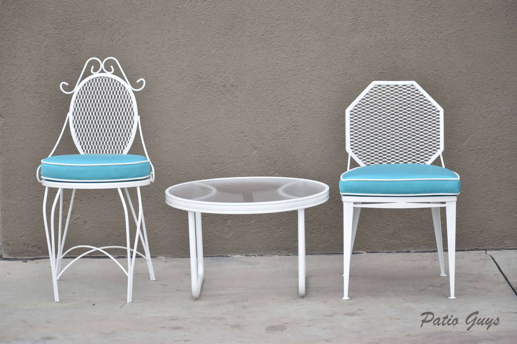 light blue chushion on white garden chairs with a round acrylic side table