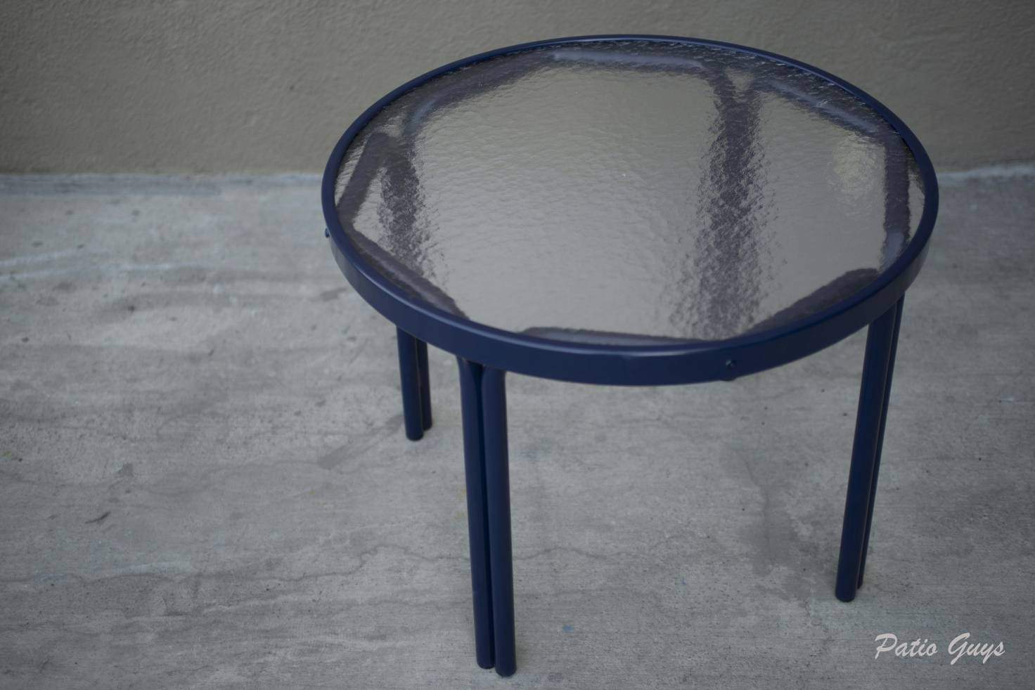 small round navy blue outdoor side table